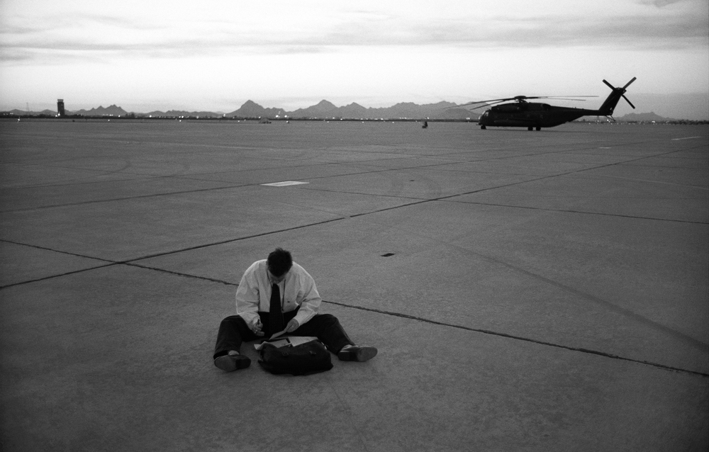 2.25.99--Tucson, AZ--Patrick Briggs, of the White House travel office,  fills out the seating assignment cards for the Press Charter plane.