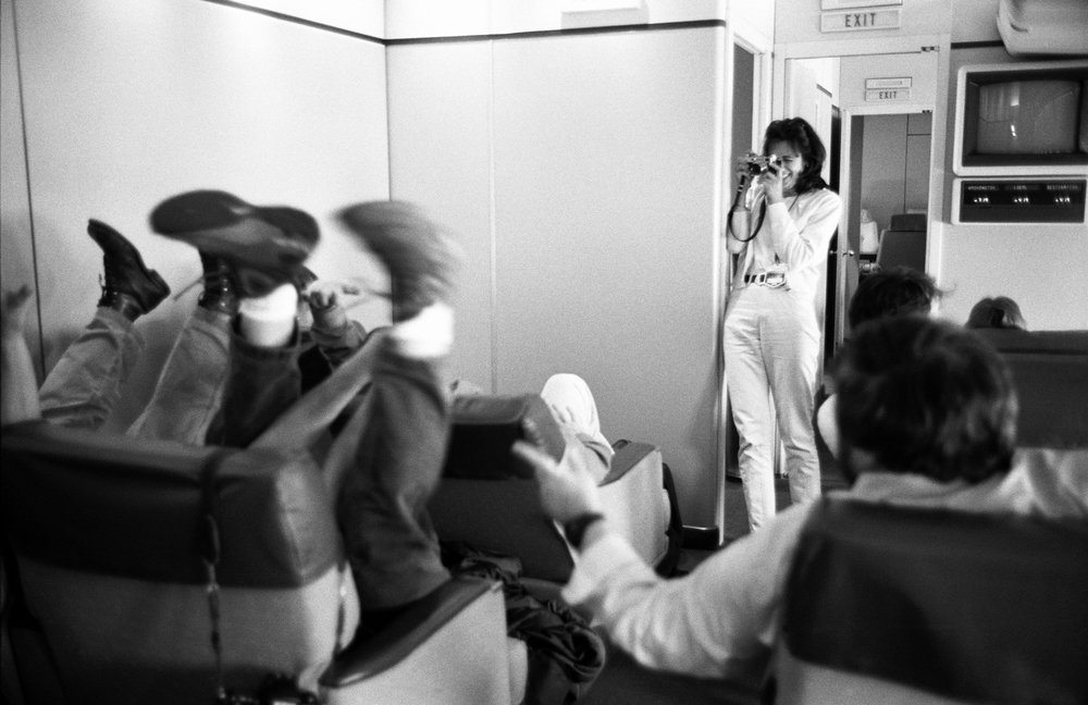 5.14.99--Air Force One--A handful of Press Corps members re-enact the previous day's heavy air turbulence on Air Force One for photographer Joyce Naltchayan and those not present for the experience.