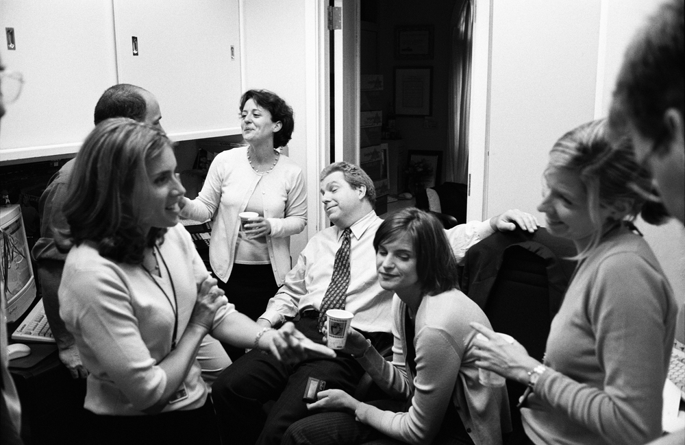 7.12.99--Washington, DC--White House Press staff members relax after hours in the West Wing at a farewell party for outgoing colleague, Michael Teague.
