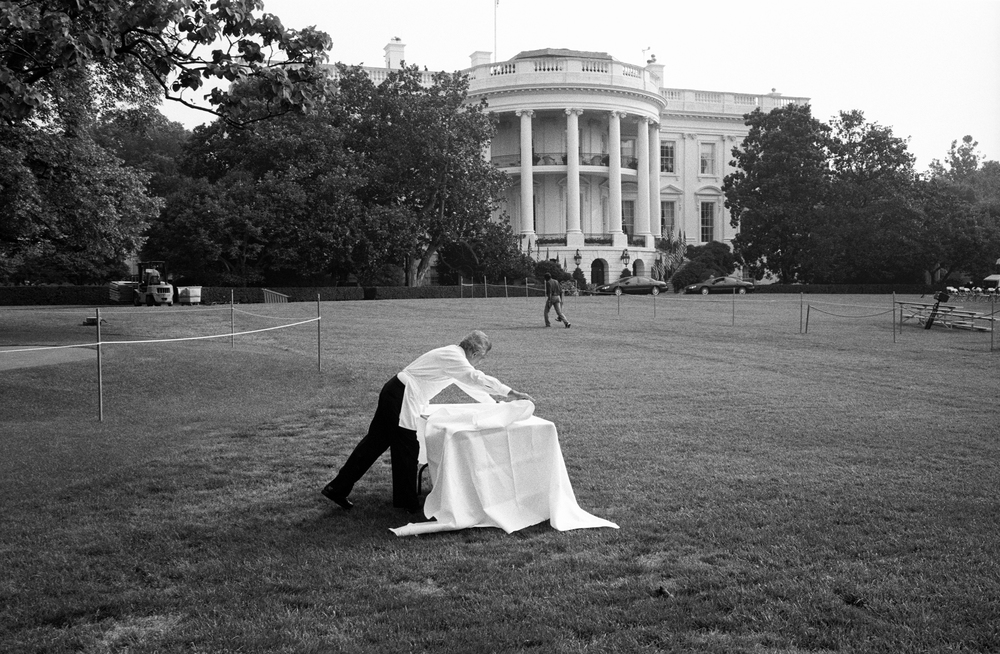 7.19.99--Washington, DC--A member of the White House Domestic Staff prepares a table on the South Lawn for an event in honor of the Women's U.S. Soccer Team – just one of the many events scheduled that day.