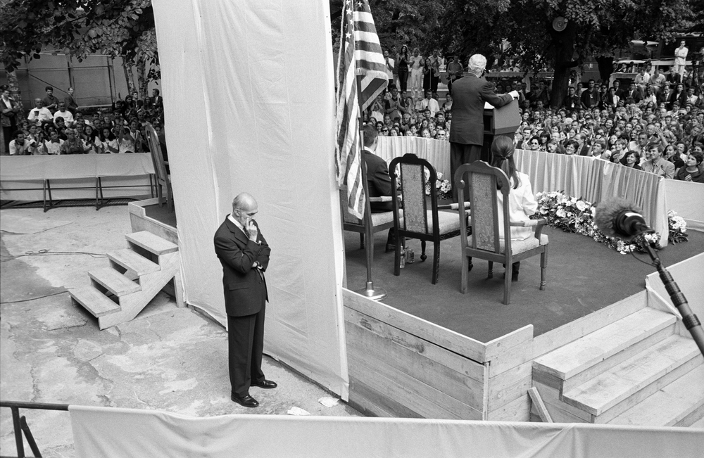 7.30.99--Sarajevo, Bosnia-Herzegovina--Ever present but unobtrusive, Clinton's PPD agent stands guard during a speech to the school community at Treca Gimnazija.