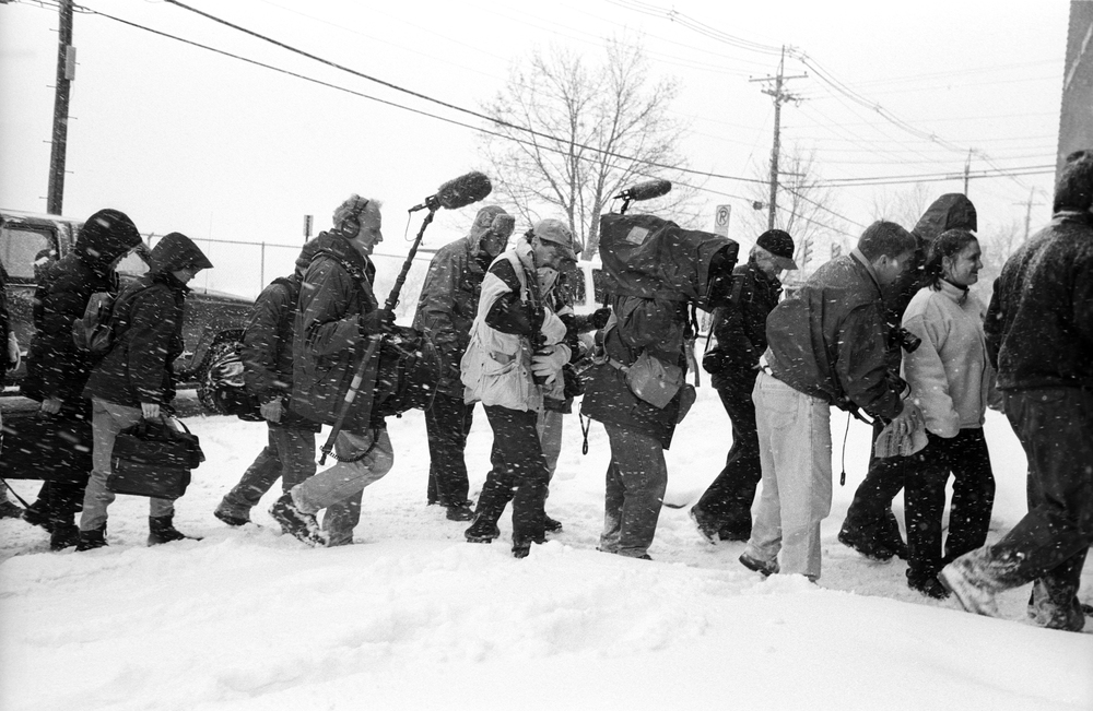 1.25.00--New Hampshire-- Members of the traveling press enter a Gore campaign event.