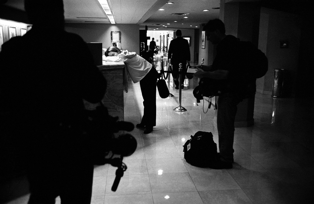 11-01-00--Orlando, FL--Miranda Cartland, a Gore campaign press aide checks into a hotel at 5:00 am, two hours before the 7:00 am pool call.