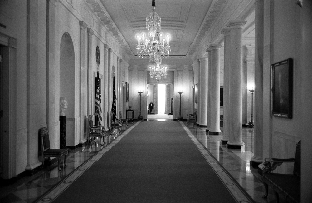 5.8.03--Washington, DC--A member of the White House waitstaff takes a break in the State Room at the end of the Cross Hall from the East Room.