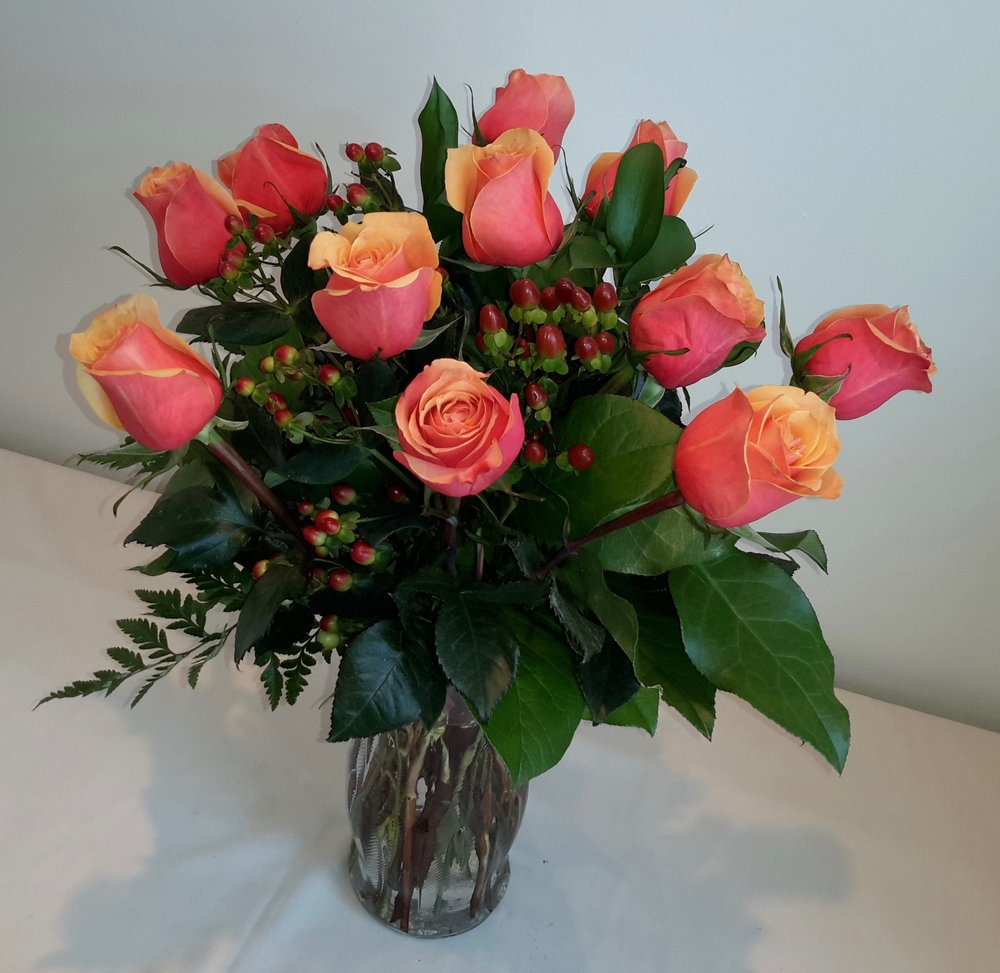 Our CLASSIC DOZEN features a bouquet of roses in seasonal colors. Always displayed with interesting textures, lush foliage and delivered in a vase, $59.