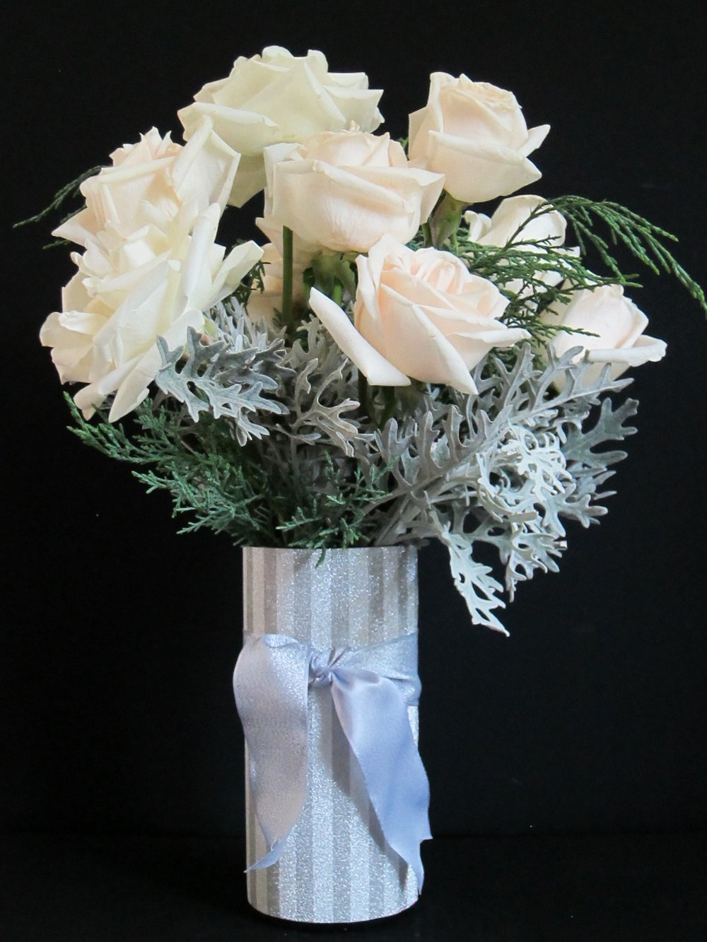 Say HAPPY ANNIVERSARY with a dozen full South American roses in a silver or gold crafted vase for $49. Lovely with red roses also.