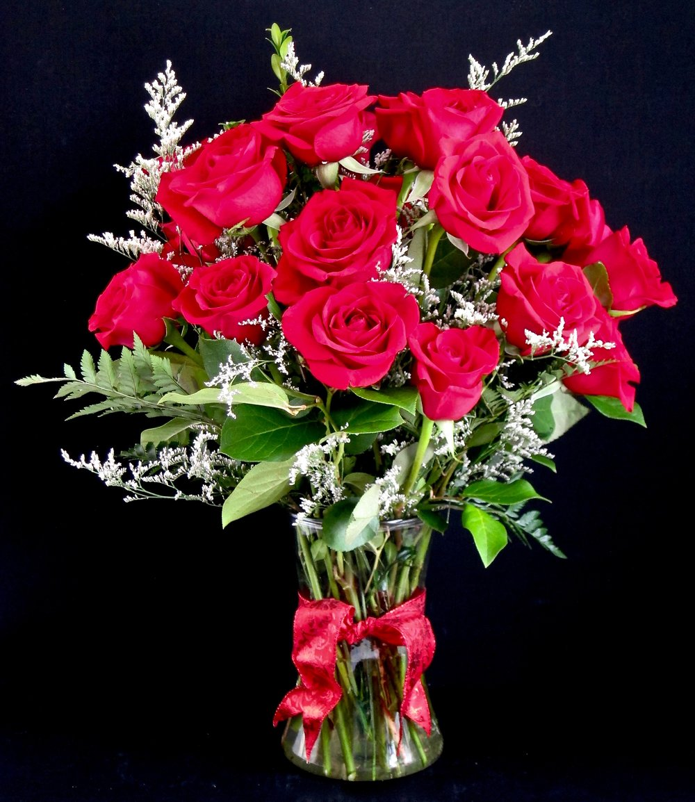TWO DOZEN RED ROSES with lovely white limonium and lush green foliages, $95.