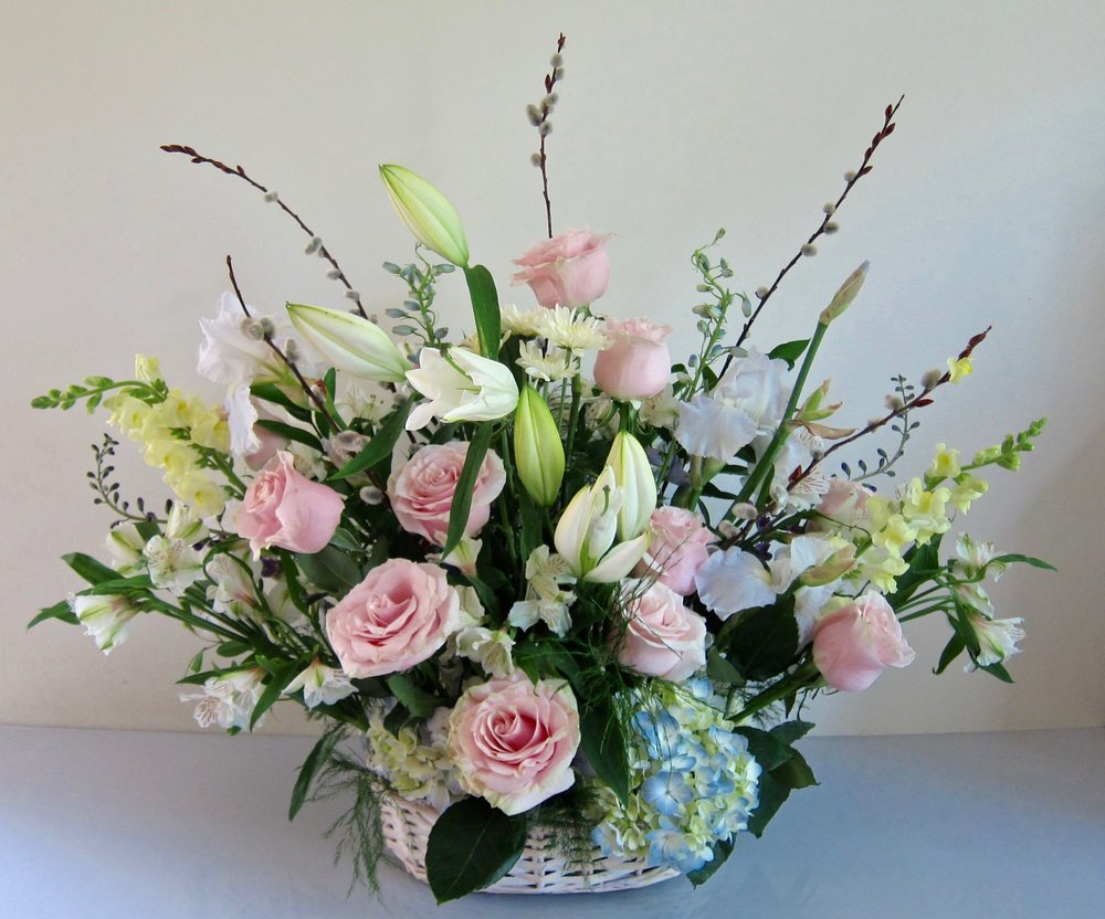 LARGE ARRANGEMENT OF SOFT COLORS   In a basket or urn with premium flowers: roses, hydrangea and lilies,  $129.  Can be done with carnations, mums and roses for  $79.