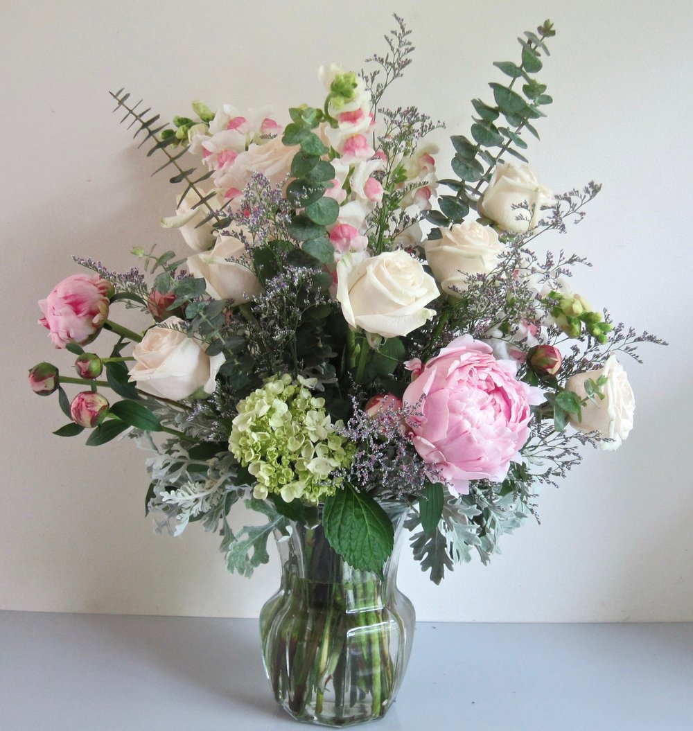 LARGE VASE ARRANGEMENT OF PREMIUM FLOWERS ONLY, $75 to $95. Premium flowers are larger and do not include mums, alstroemeria or carnations. This one features peonies, bi-color snaps, roses and hydrangeas.