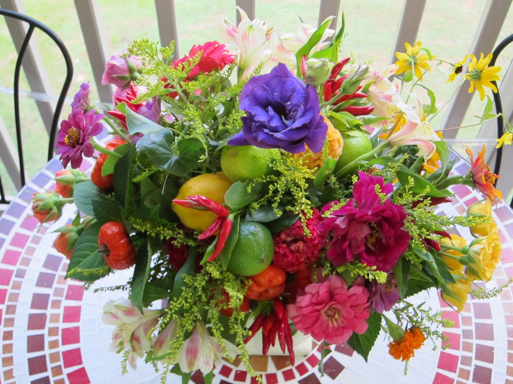 MARGARITA fruit and flowers in a footed compote is just one kind of a della robia centerpiece we can create for your event.