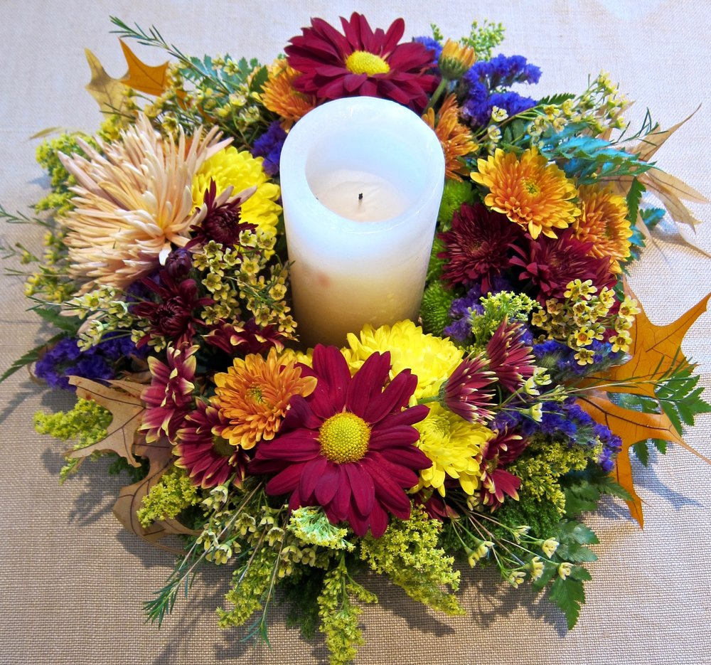 FRESH FLORAL CENTERPIECE with pillar candles or tapered candles, $49 and up. Please give us advance notice.