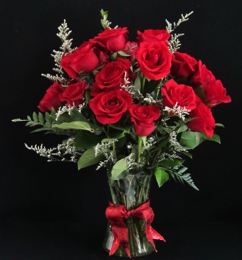 CLASSIC RED   Two dozen, with lush lemon leaves and ferns, accented with misty limonium,  $95  ONE DOZEN,  $55.