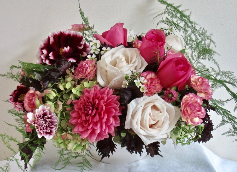 LOW ROUND CENTERPIECE in white bowl with hydrangeas, roses and other premium flowers, $70.