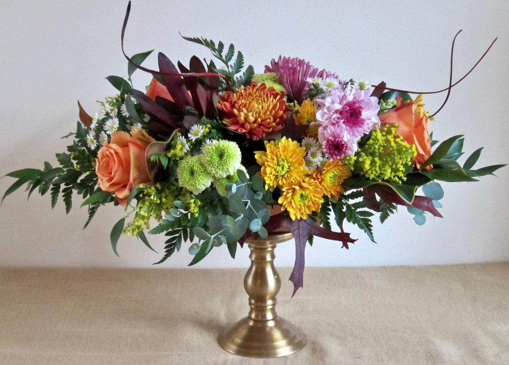 ELEVATED fall oval centerpiece onto a pillar candle stand, $55. We can provide the stand for an additional $20.