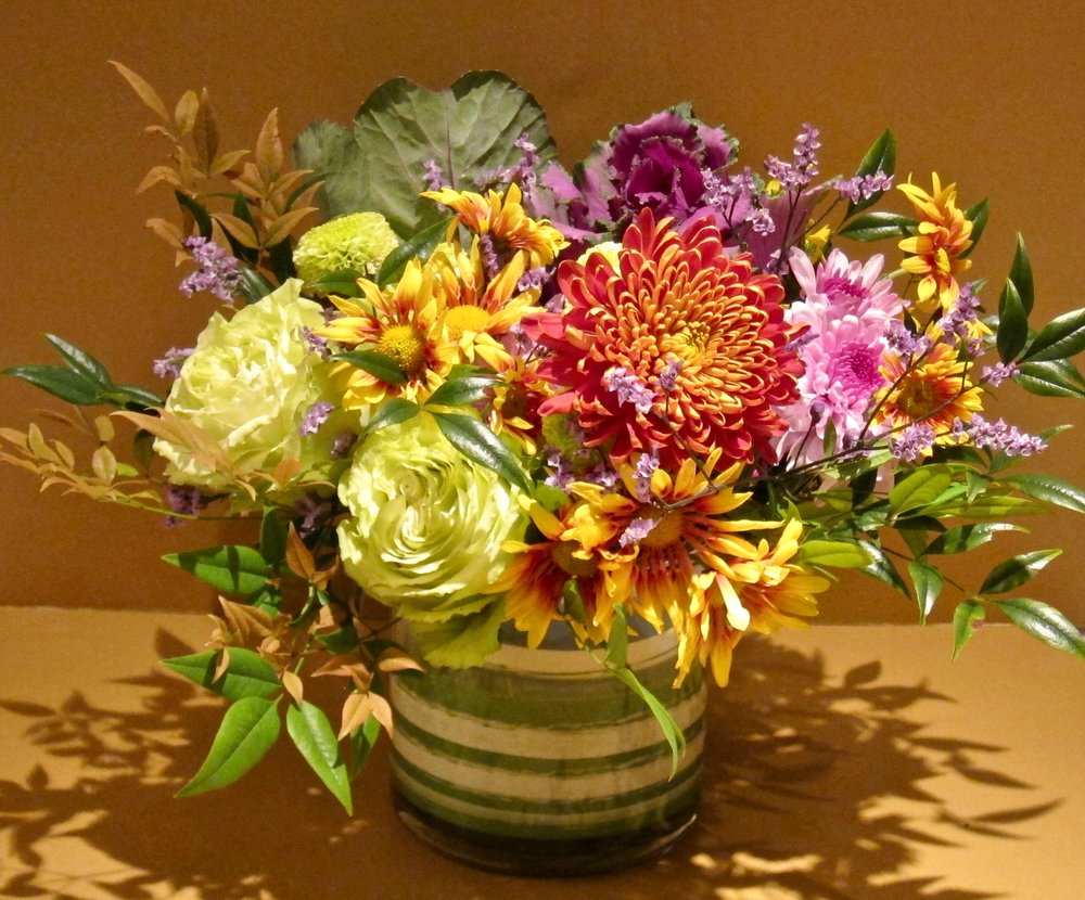 AUTUMN TONES in lined cylinder vase, $55, about 15 inch diameter by 13 inches high.