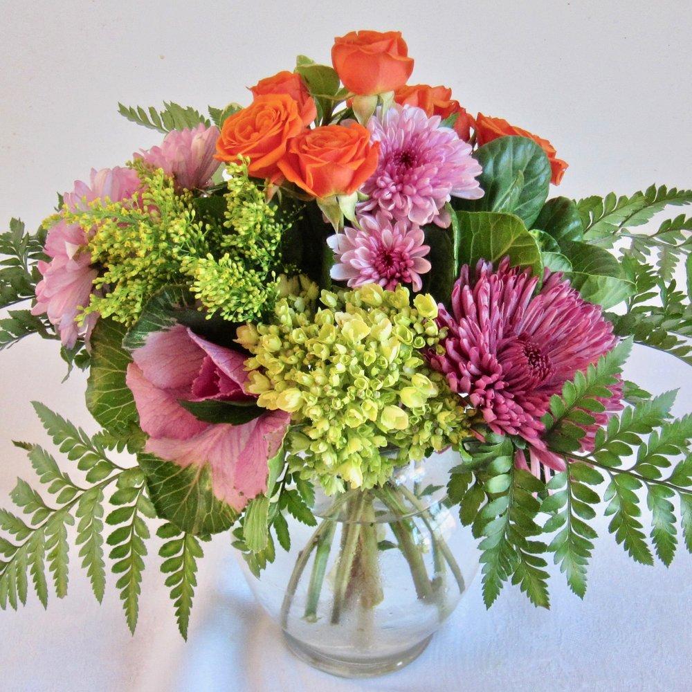 SHORT N SWEET mound of seasonal flowers in a low vase,$40.