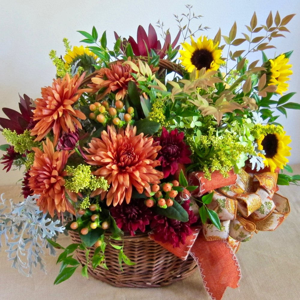 FALL FLORALS in a large basket with bow, $85.