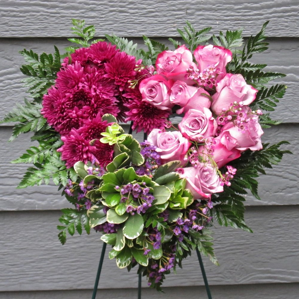 """OPEN HEART easel arrangement can also be laid flat on a tabletop. 15"""" length and width (with flowers), $99. Larger 24"""" open heart, $199."""
