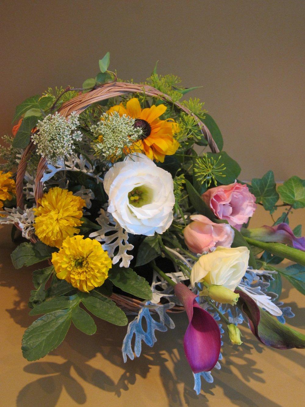 LOW BASKET of seasonal flowers, $45.