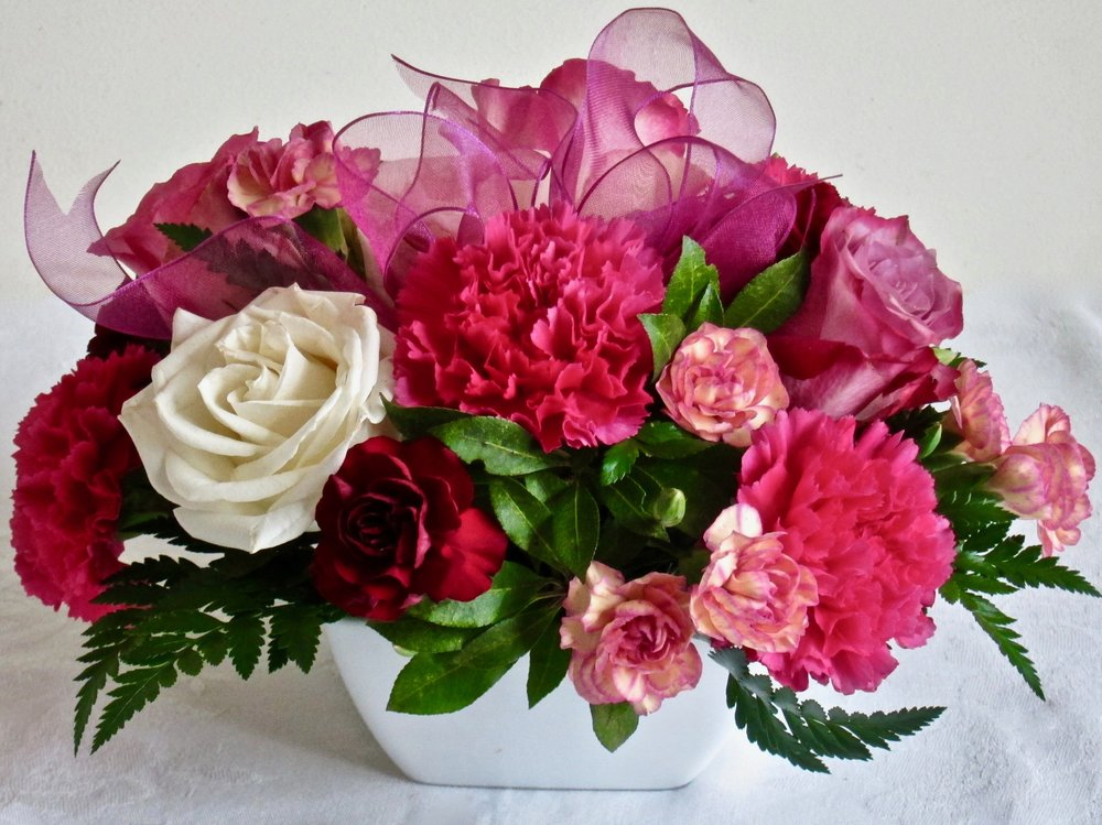 VALENTINE MEDLEY   Long-lasting roses and carnations in a white ceramic dish,  $49  Valentine's Special! About 12 inches all around.