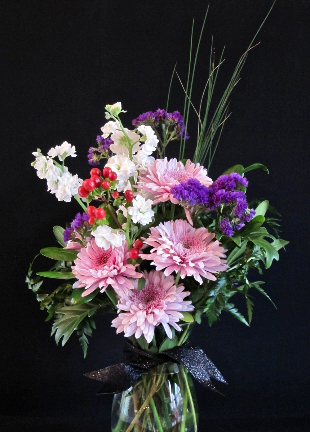MR. SOPHISTICATE Elegant large flowers with accents of interesting foliages. Add a black bowtie for him, $45.