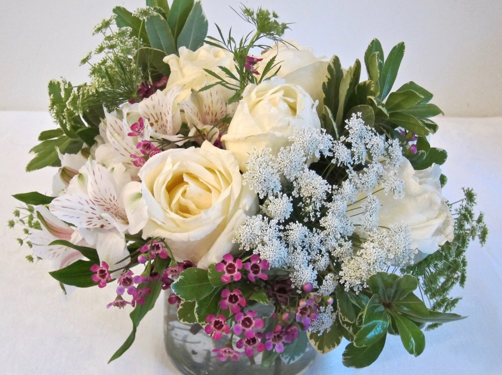 LOW AND LACEY   Beautiful whites with lacey accents in leaf-lined cylinder vase, $55