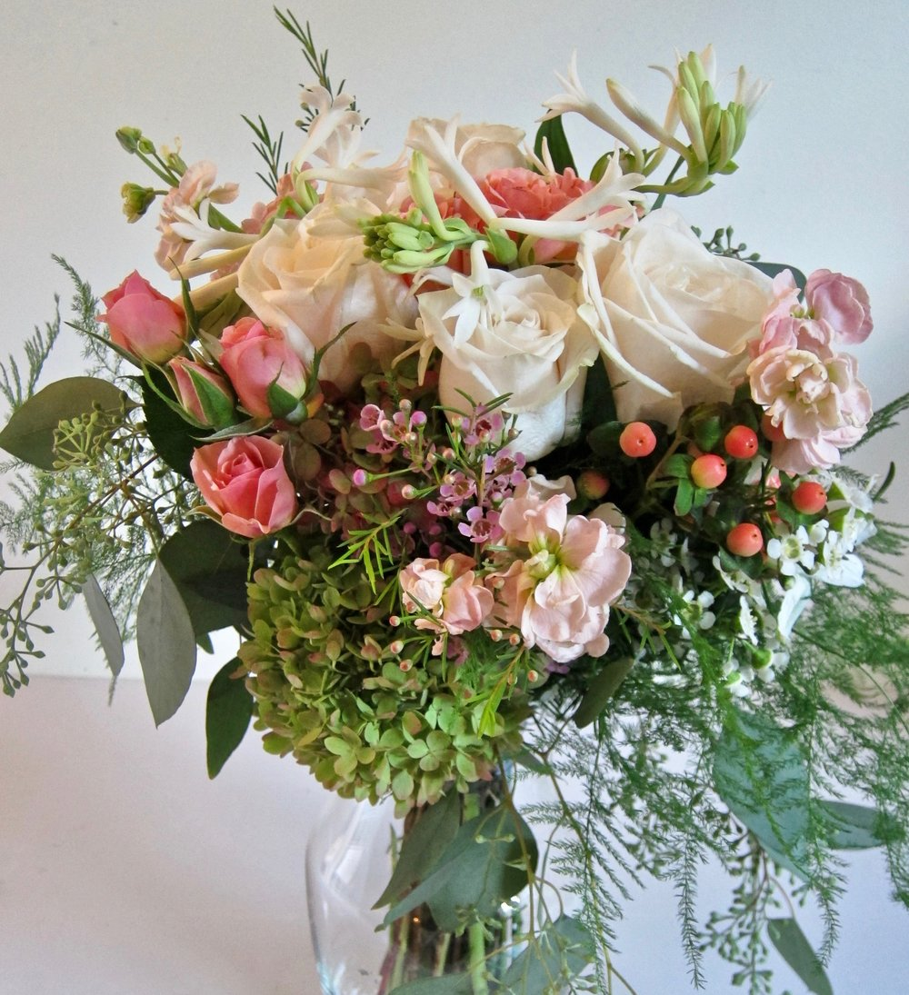 BRIDAL BOUQUETS   Seasonal flowers are priced according to size and selection of flowers.
