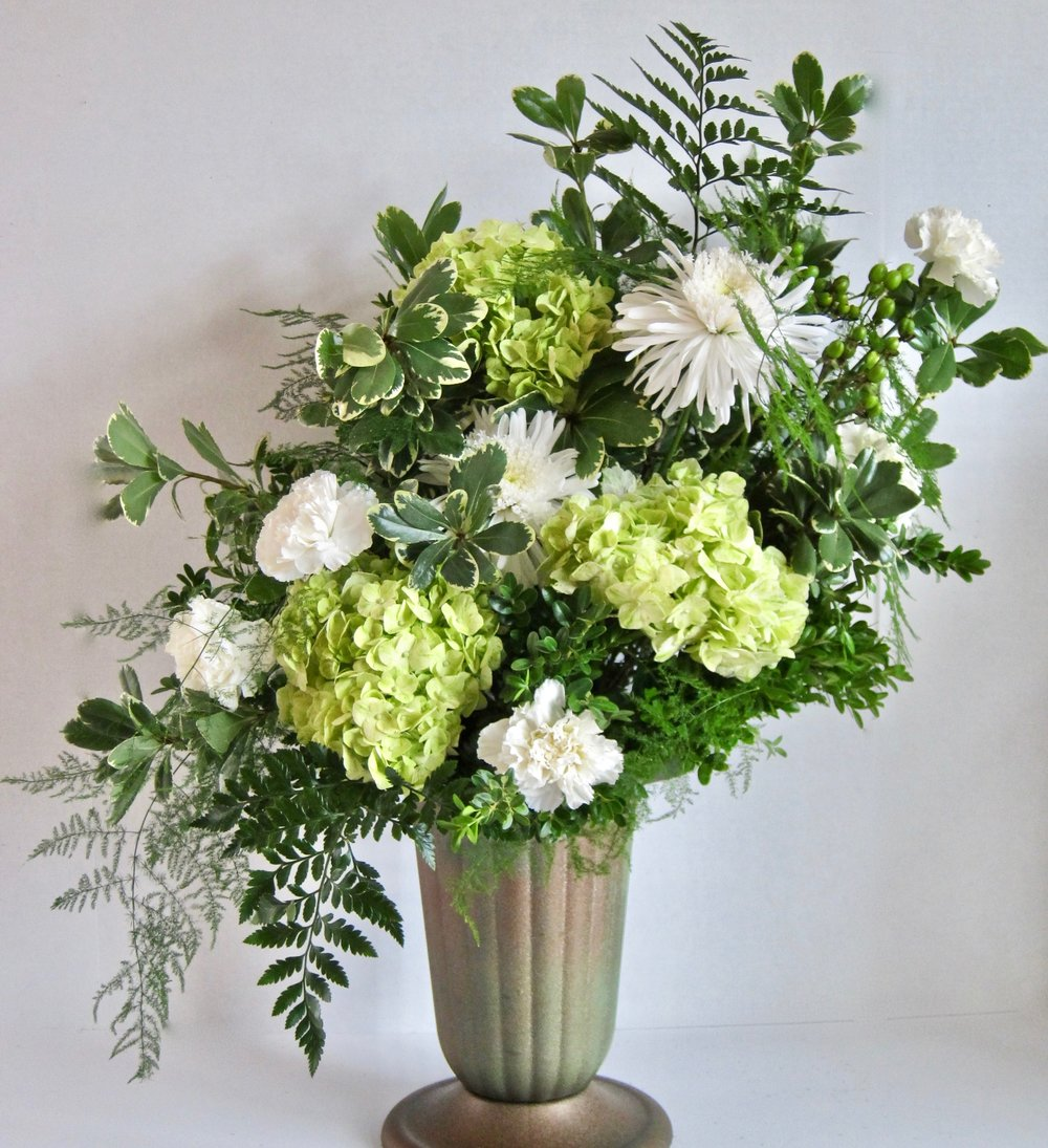 INDOOR-OUTDOOR URN   Large green and white arrangement, starting at  $75