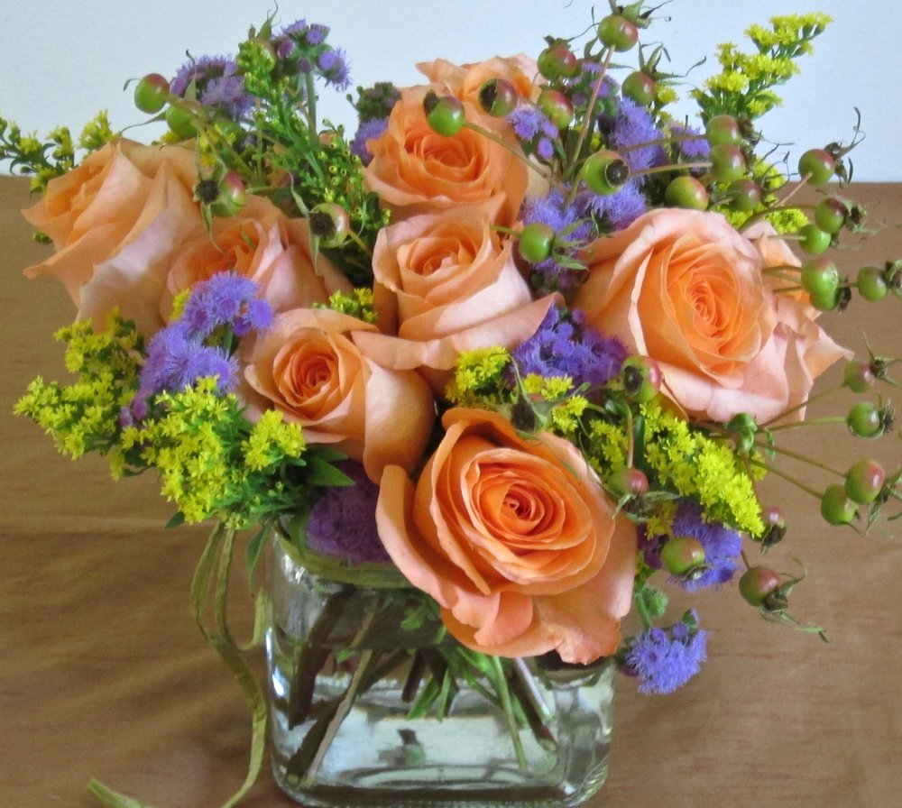DOZEN CUBED ROSES    A dozen roses accented by seasonal fillers in a 5 inch cube or cylinder vase, with or without leaf-lining, $75.