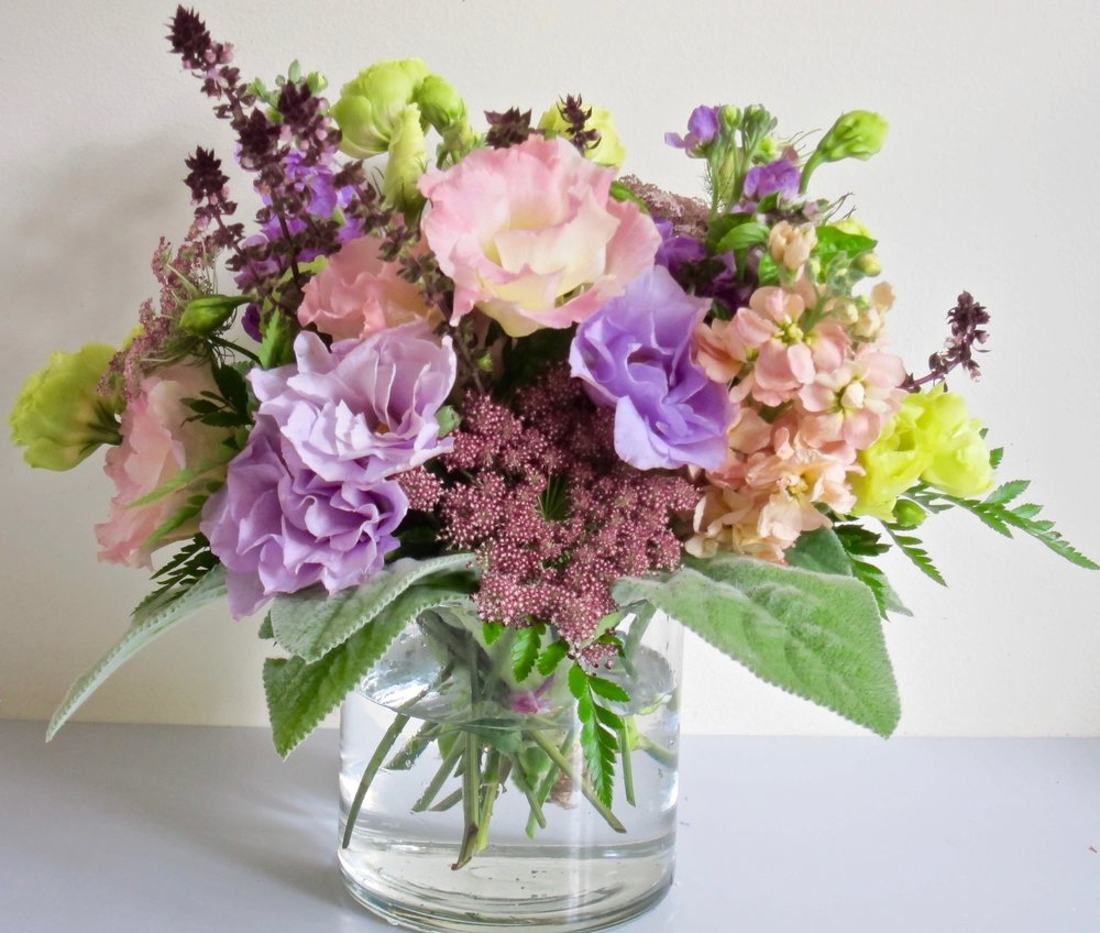 LIZZY AND THUS   Apricot and lavender lisianthus are accented with dreamy chocolate daucus, fragrant cinnamon basil and peach stock, $55.