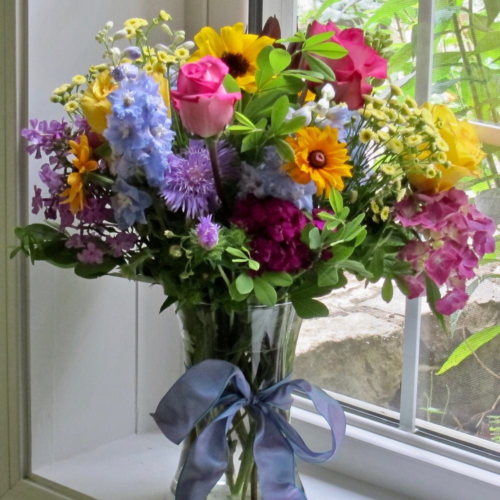 LARGE SEASONAL VASE BOUQUET   Spring bulbs, roses and daisies in a tall gathering vase, $65 to $75.