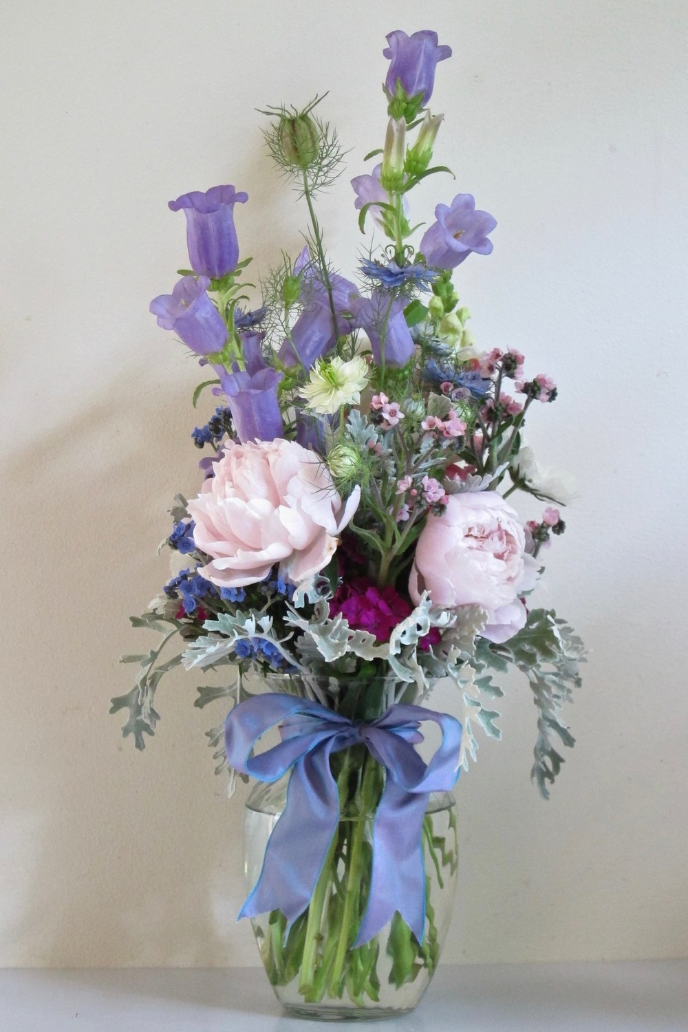 PASTEL PEONIES   and blue campanula bells, white scabiosa, nigella pods and dusty miller, $45.
