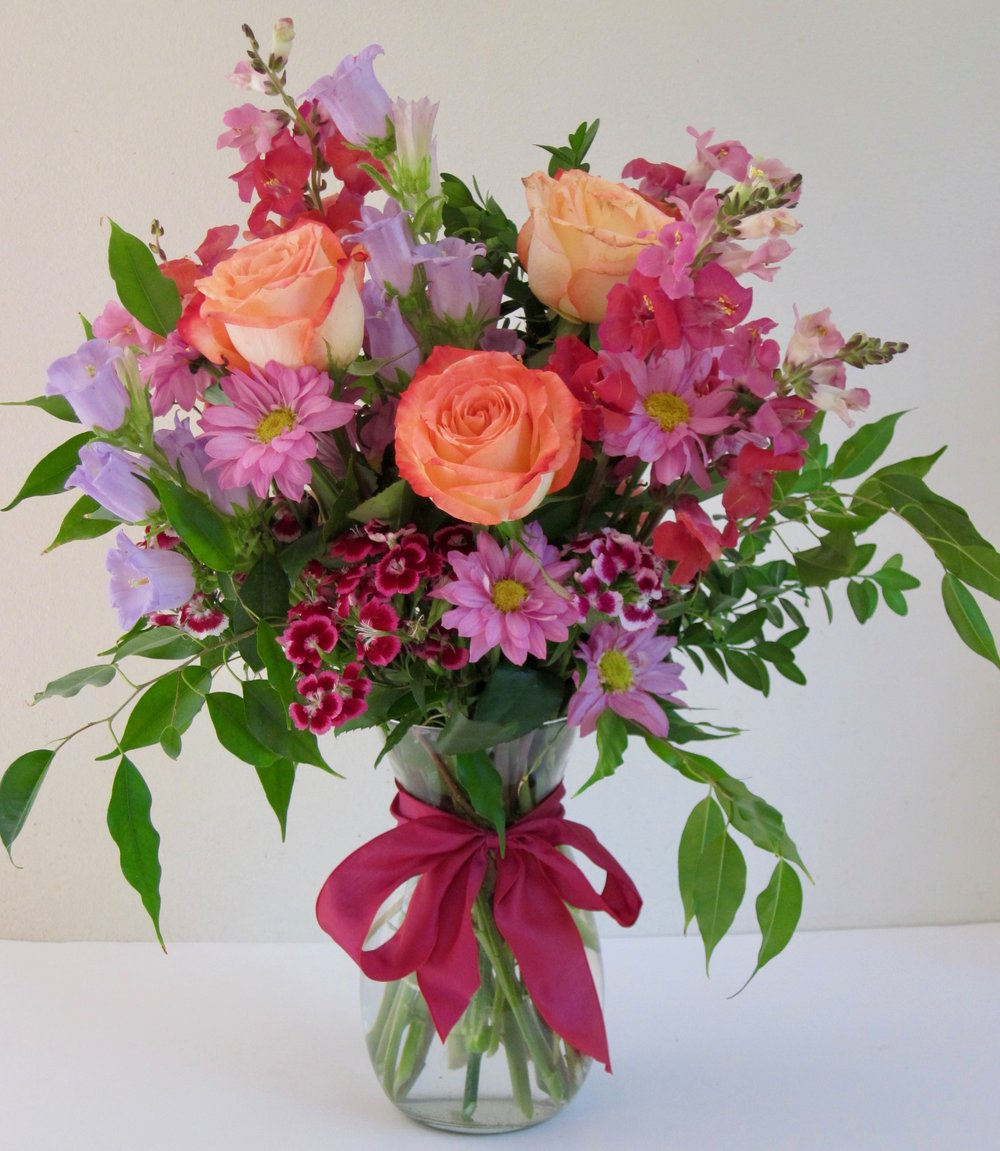 BIRTHDAY BOUQUET   Colorful mixed seasonal flowers in a 7 inch vase, $45.