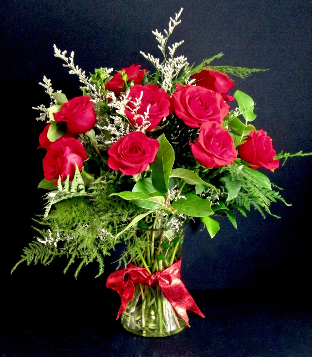 CLASSIC DOZEN   Dozen roses of any color accented with mistyand lush foliages, $65, two dozen, $95.