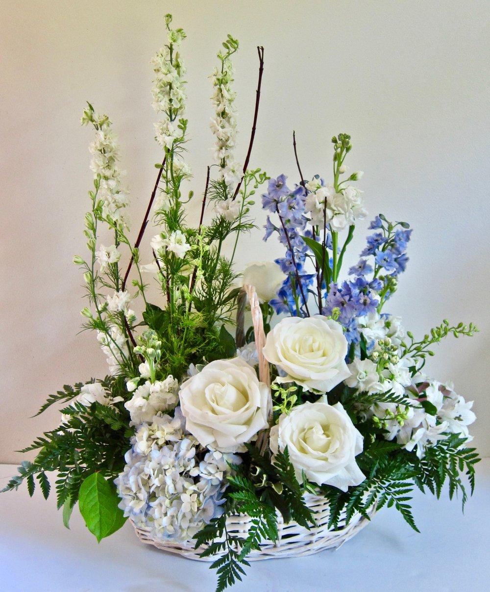 LARGE PREMIUM BASKET    Large basket of premium flowers; lilies or hydrangeas, roses, hydrangeas, snapdragons or larkspur or delphinium, $110, in white or tan basket .