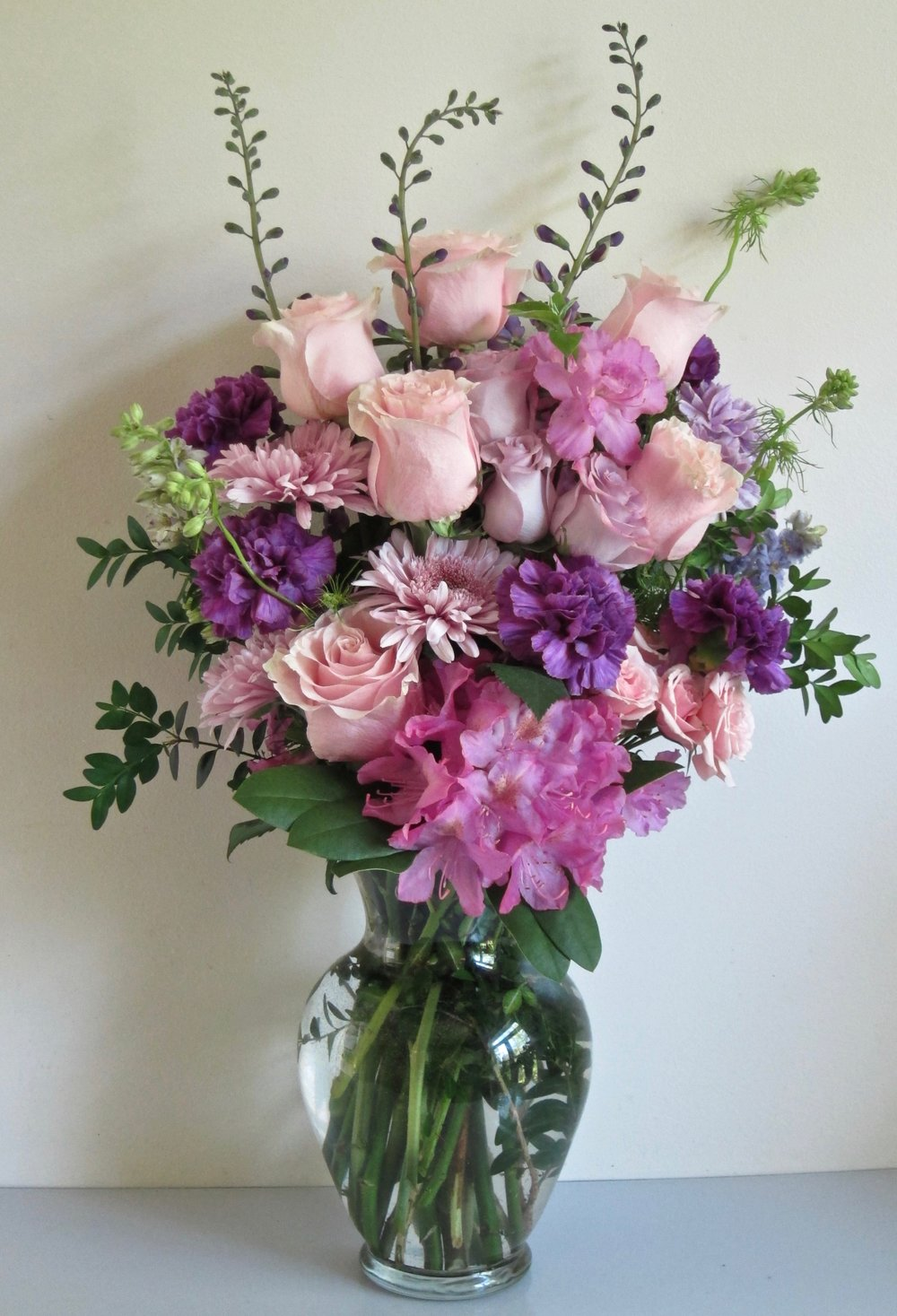 LARGE VASE BOUQUET    Pinks and purples with line flowers such as delplhinium or larkspur, $65.