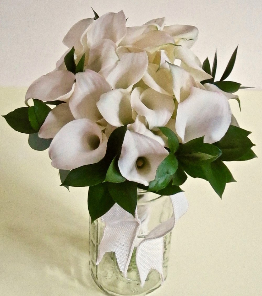 BRIDAL BOUQUET, FORMAL HAND TIED   Seasonal flowers are priced according to size and selection of flowers.