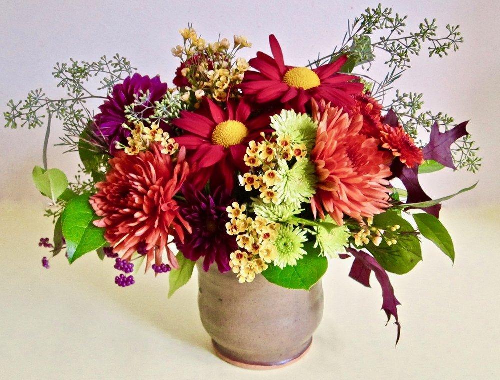 FALL CERAMIC    Contemporary arrangement of seasonal specialty flowers in a keepsake ceramic vase, $55 to $65.