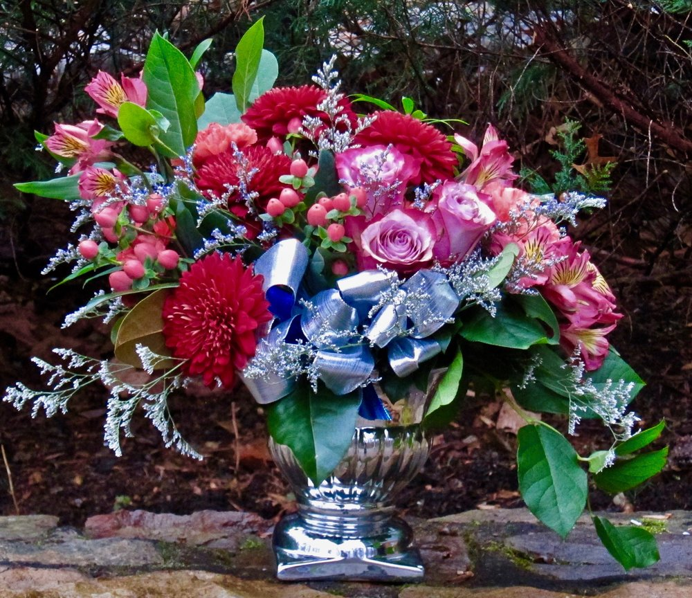 SILVER OR GOLD CENTERPIECE with berries, roses, cremons, carnations and alstroemeria highlighted with misty, $75.