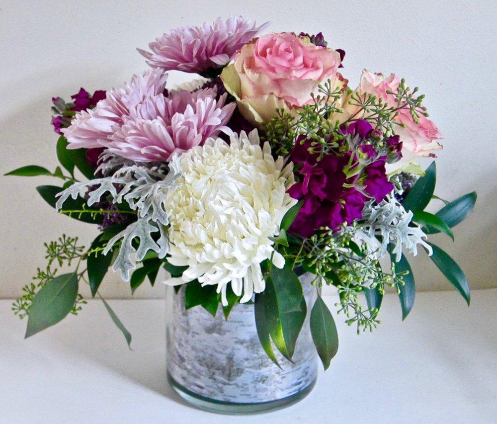BIRCH LINED vase with seasonal flowers, $50.