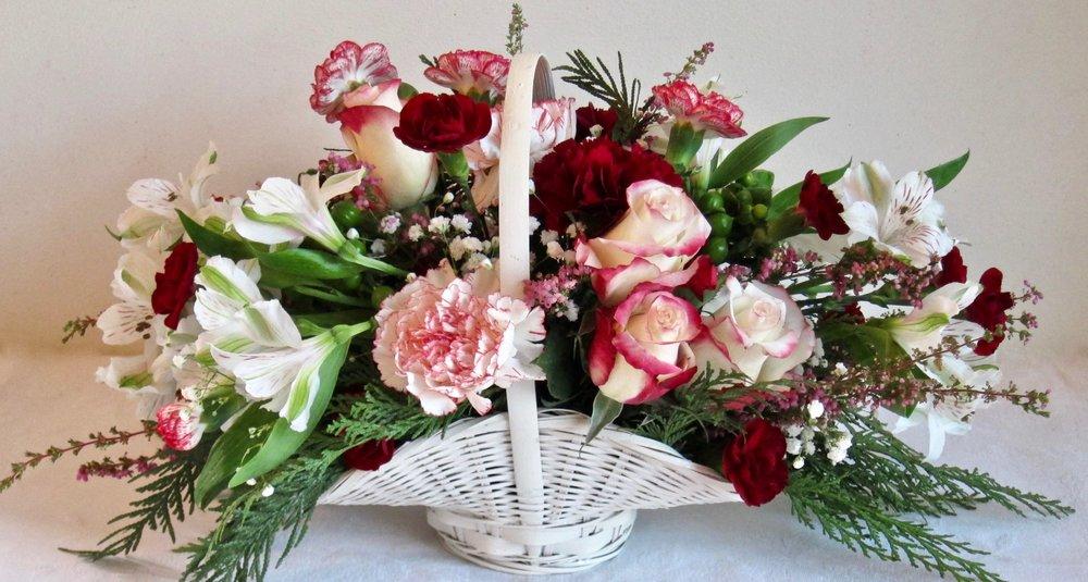 MEDIUM BASKET ARRANGEMENT   Seasonal flowers in a medium white or brown grapevine basket., $60.