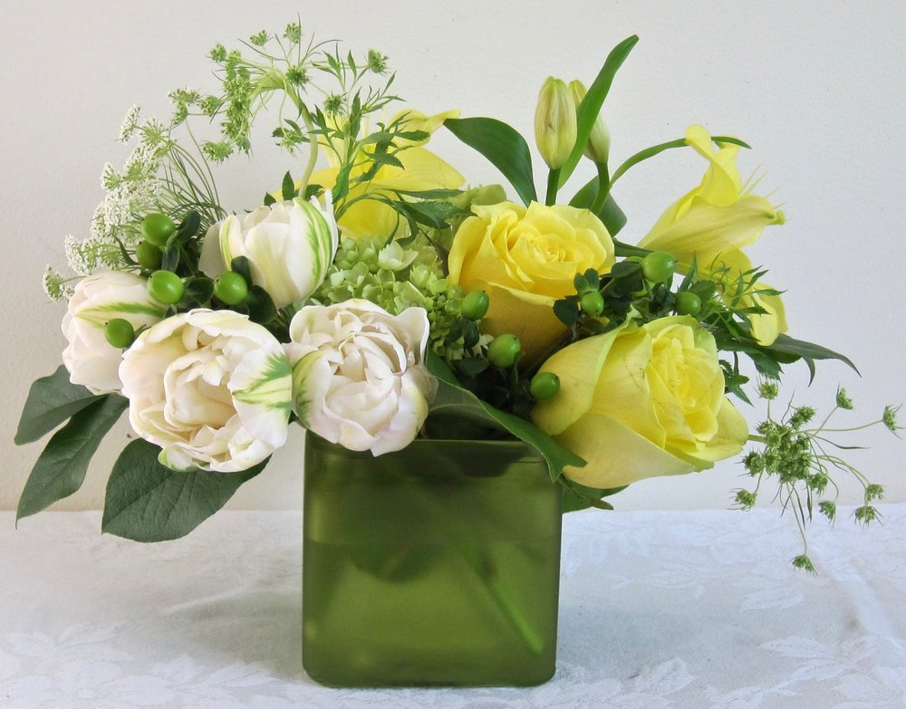 CITRUS  Hydrangea, tulips and roses in a lime cube vase, $45.