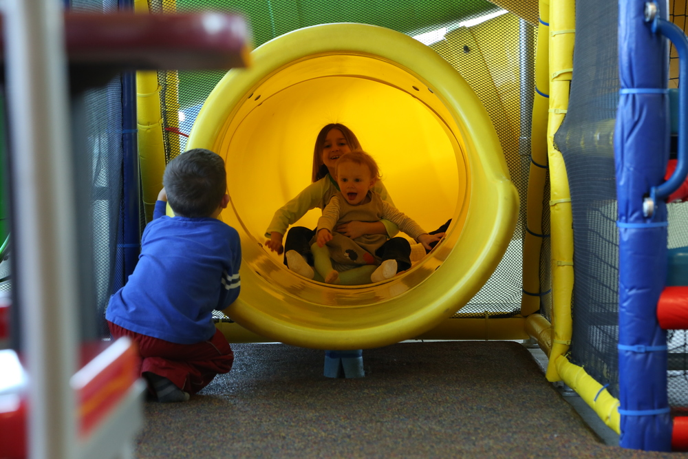 G going down the slide with her hero of the day (OK, my hero because I didn't have to climb up in there this time)