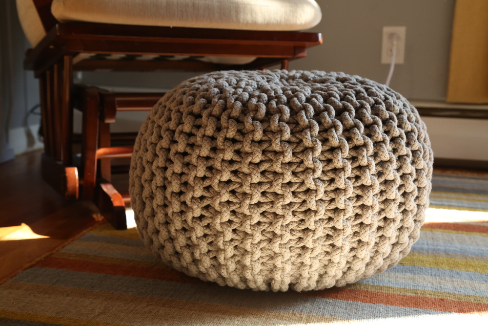 I needed a place to prop my feet for nursing, but the gliding ottoman that came with the chair was getting dangerous with my climbers around.  This knitted pouf was the perfect solution.  You can get cute ones at Land of Nod, but I found this one for half the price on Amazon.