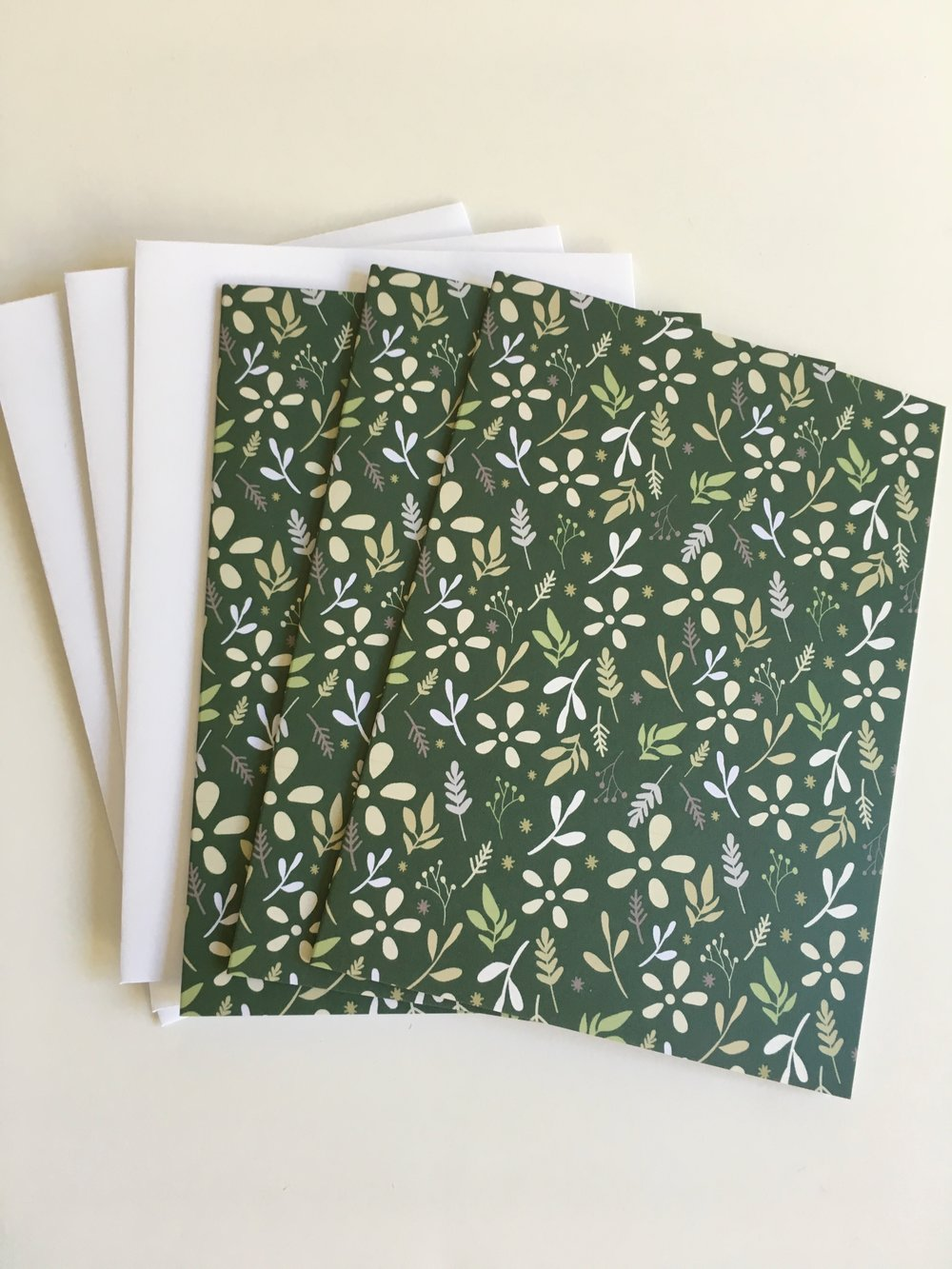 Dark green tossed floral patterned cards