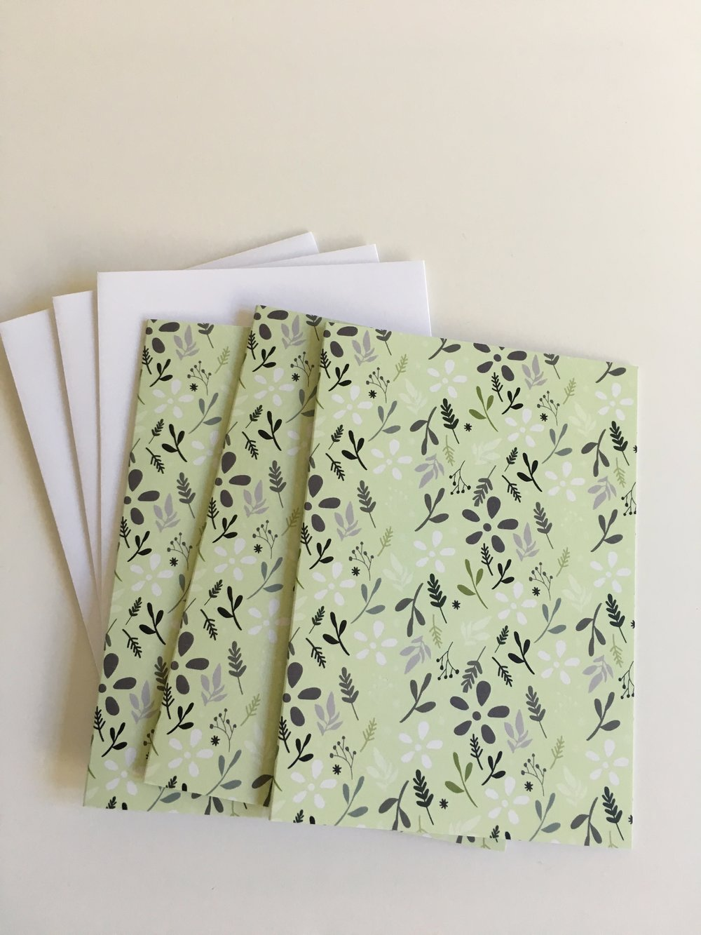 Light green tossed floral patterned cards