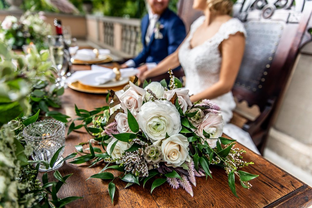 WeddingHeadTableFlowers.jpg