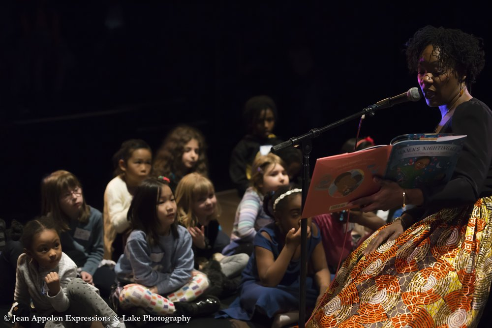 Sadada Jackson reads Edwidge Danticat's book Mama's Nightingale: A Story of Immigration and Separation to our young audience members during JAE's child-friendly matinee of Lakou Ayiti.