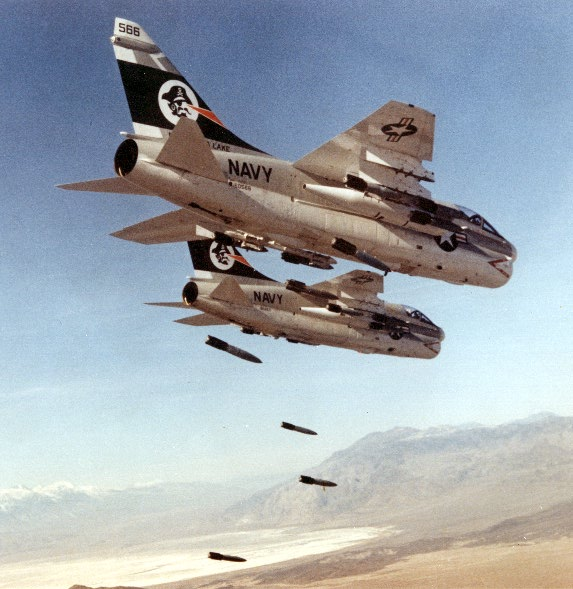 "FLIR-equipped A-7 Corsairs dropping Snakeyes (unretarded) on China Lake target range; the A-7E WSSA, which began as a Fleet- support project and an avionics ""brush-up,"" became the prototype for aircraft-weapons integration and avionics software activities."