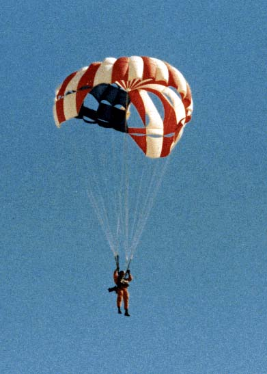 Naval Test Parachutist during qualification jump at China Lake; in 1979 China Lake became the Navy site for RDT&E of canopies and associated gear, including downsized harnesses for female aircrew, emergency (ejection-seat) 'chutes, special-forces staged parachutes, and the Space Shuttle emergency-egress system.